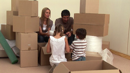 Animation of a family relaxing between boxes Animation