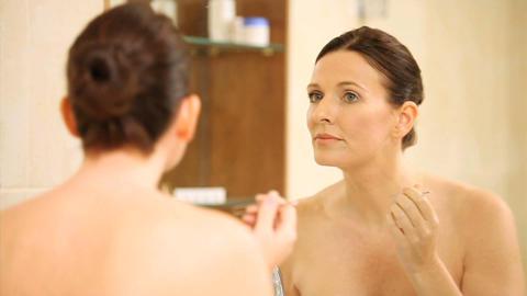 Woman plucking eyebrows with tweezers Footage
