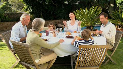 Family having dinner outside Footage