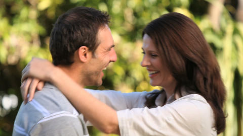 Woman hugging her husband and they smiling at the  Footage