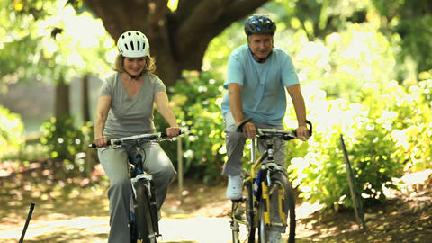 Elderly couple walking with bikes Footage