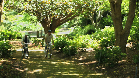 Elderly couple biking together Footage