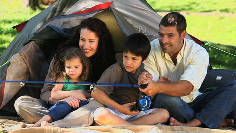 Happy family fishing in front of the tent Footage