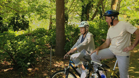 Old woman and man on bikes looking of their way Footage