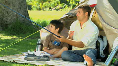 Father and son fishing together Footage
