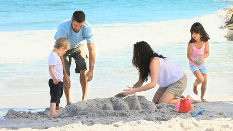 Family building a sand castle Footage