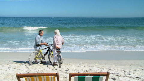 Elderly couple with bikes talking Footage