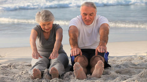 Elderly couple doing flexibility exercices Footage
