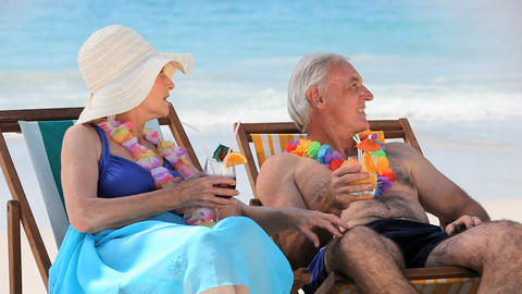 Elderly couple drinking cocktails Footage