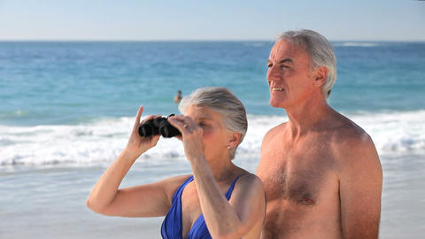 Elderly couple looking through binoculars Footage