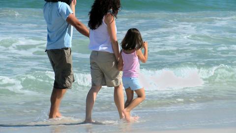 Family walking along the sea Footage