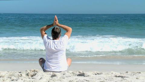 Elderly man doing yoga Footage