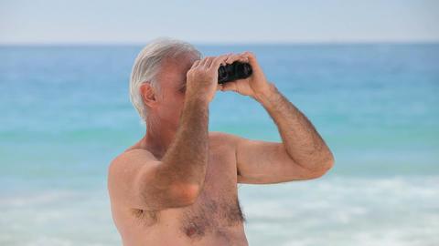 Elderly man looking through binoculars Footage