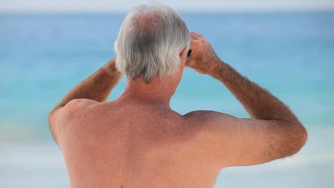 Aged man looking through binoculars Footage