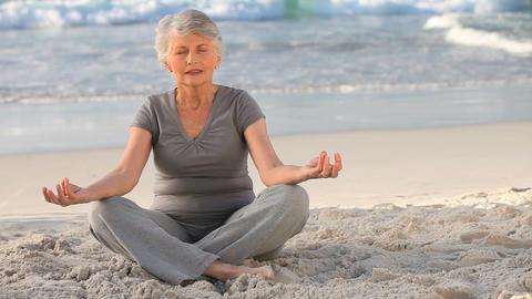 Elderly woman doing yoga Footage