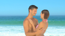 Couple hugging on a beach Footage