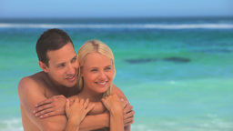 Loving couple hugging on a beach Stock Video Footage