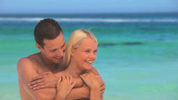 Loving couple hugging on a beach Footage