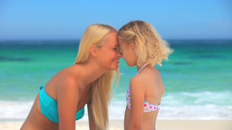 Mother and daughter having fun on the beach Footage