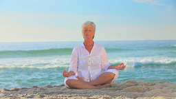 Mature woman doing yoga exercises Footage