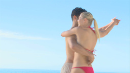 Beautiful couple dancing on a beach Footage
