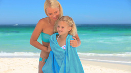 Blonde woman drying her daughter ater a swim Footage