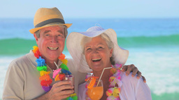 Elderly couple wearing garlands and hats Footage
