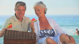 Mature couple eating juicy watermelon Footage