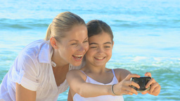 Mother and daughter taking pictures Footage