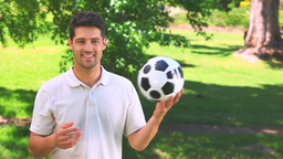 Young man playing with a ball Footage