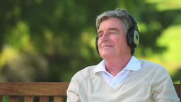 Mature man listening to music Footage