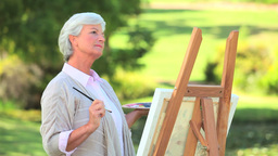 Mature woman painting Footage