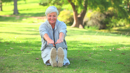 Mature woman doing her stretches Footage