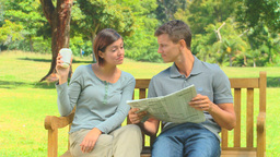 Young couple reading a newspaper Footage