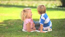 Two young children talking together Footage