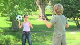 Young boy and his sister playing with a ball Footage