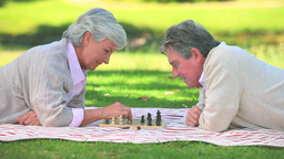 Mature couple playing chess Footage