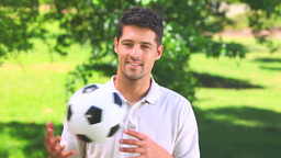 Young man playing with a ball outdoors Footage