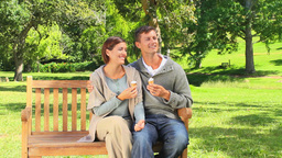 Young couple eating icecream outside Footage