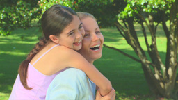 Young woman having fun with her daughter Footage