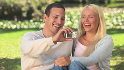 Young couple taking a photo of themselves Footage