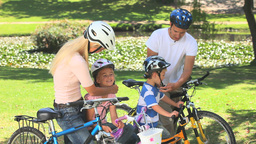 Family preparing to go cycling Footage