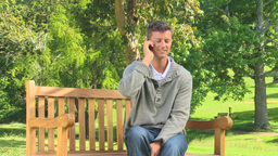 Young man having a phone conversation outdoors Footage