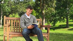 Young man reading a book outside Footage