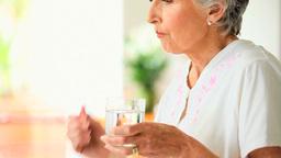 Elderly woman taking a pill Footage