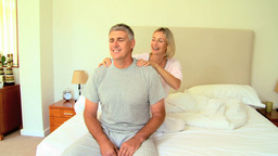 Young woman giving her husband a massage Footage