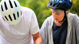 Mature couple getting ready for riding bicycles Footage