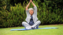 Mature woman doing yoga Footage