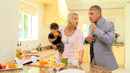 Man in kitchen hurrying up before going to work Footage