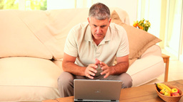 Man triumphant after transaction on his laptop Footage